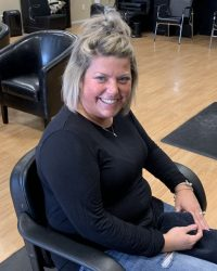 Courtney Potter sitting at hair designs